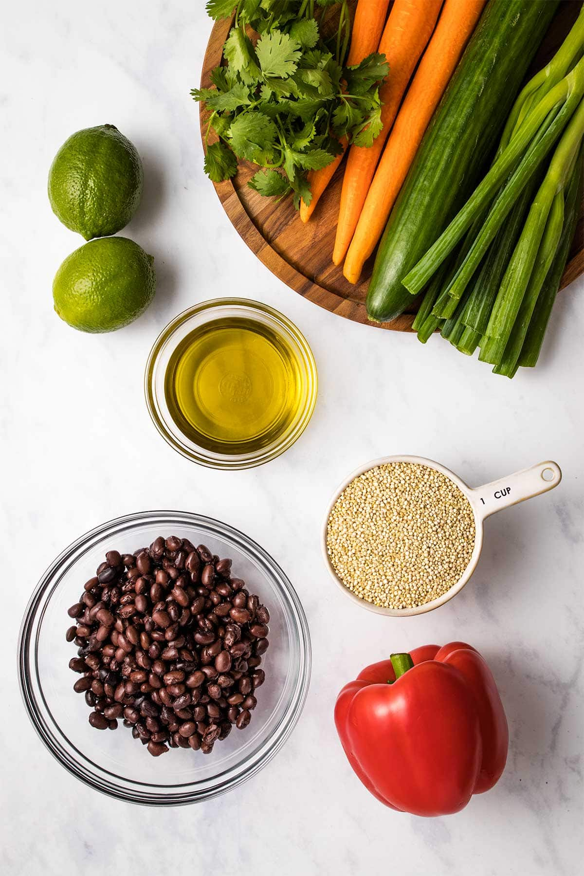 Ingredients for quinoa black bean salad in glass bowls