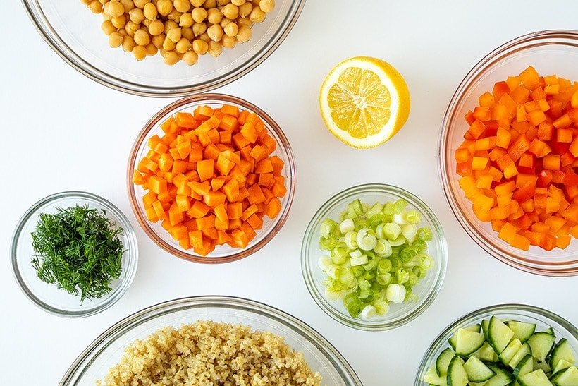 ingredients for quinoa chickpea salad in glass bowls