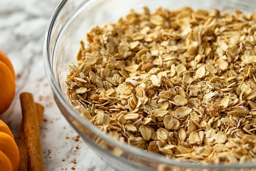 rolled oats, pumpkin spices, salt and baking soda mixed in a glass bowl
