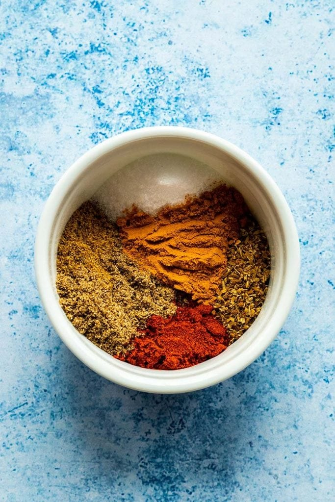 Tikka masala spice blend in a white bowl viewed from overhead