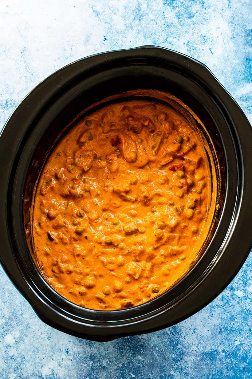 Potato and chickpea tikka masala in a slow cooker viewed from overhead
