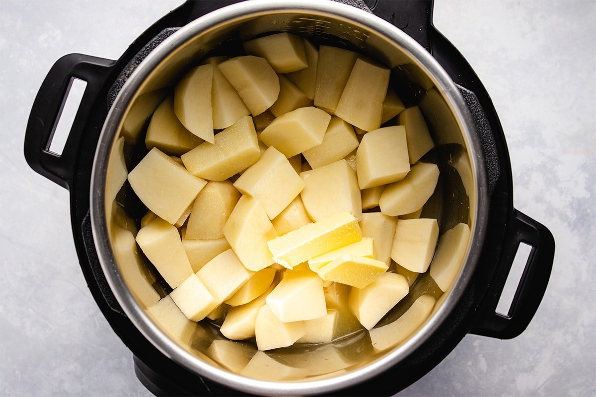 Yellow diced potatoes, butter, salt and broth in an Instant Pot