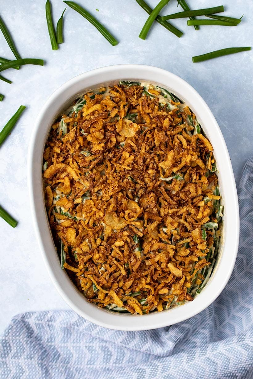 vegan green bean casserole in a white dish viewed from overhead