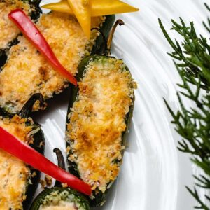 A close up of a jalapeno popper that is part of a Christmas Tree platter