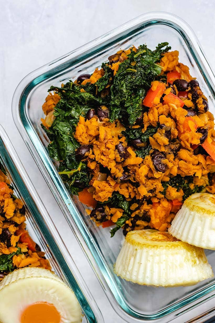 Sweet Potato, Kale and Black Bean Breakfast Skillet in glass meal prep containers served with egg muffins