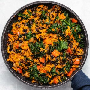 Sweet Potato, Kale and Black Bean Breakfast Skillet in a black skillet viewed from overhead