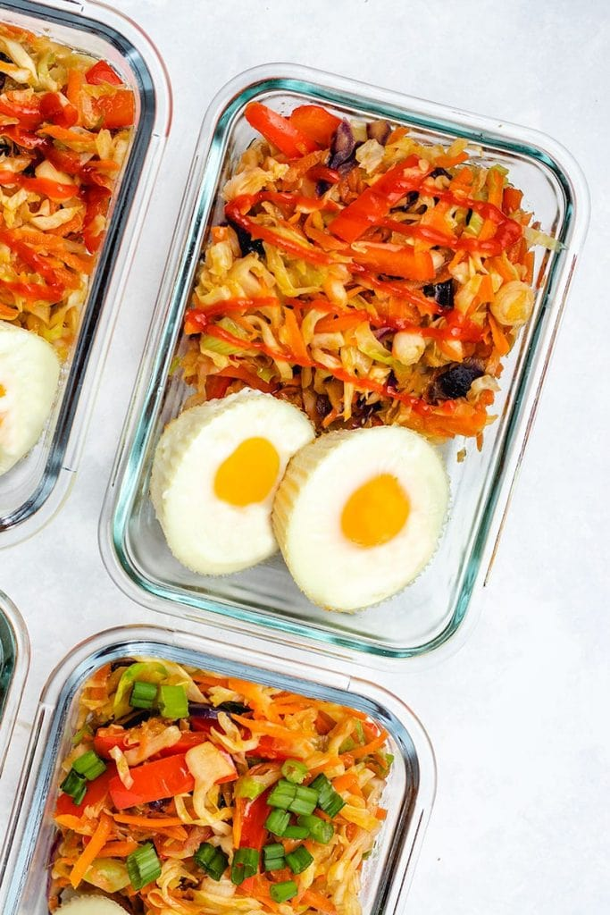 egg roll in a bowl served with two egg muffins in glass meal prep containers