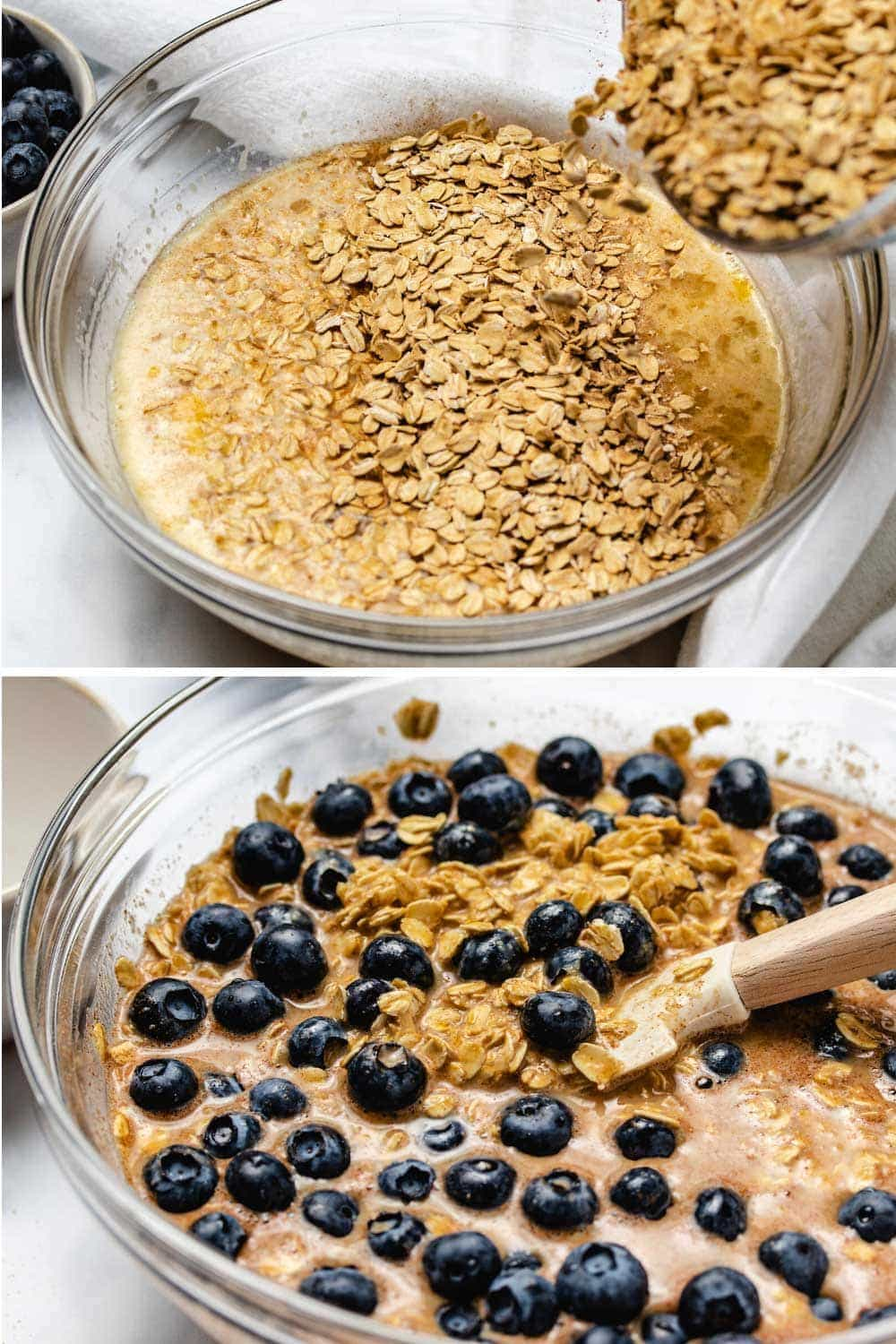 First photo shows dry ingredients for baked oatmeal being added to wet ingredients in a large glass bowl. Second photo shows fresh blueberries being folded into the same bowl.