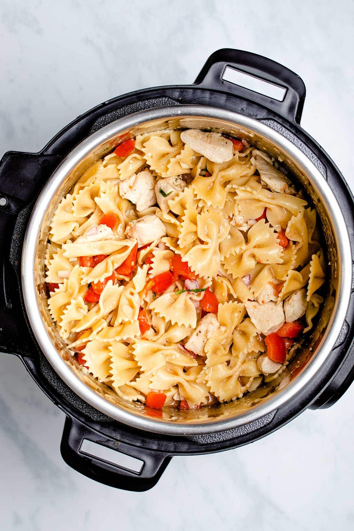 Bruschetta Chicken Pasta in an Instant Pot viewed from overhead