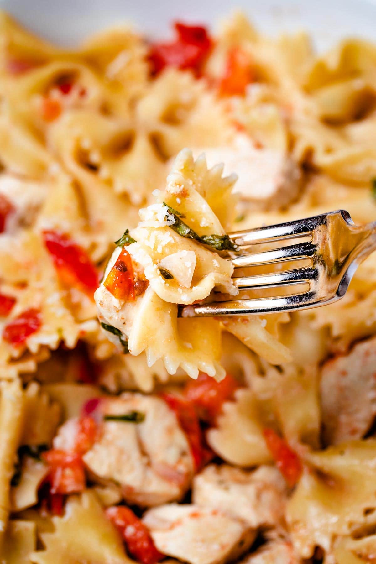 a forkful of Instant Pot Bruschetta Chicken Pasta