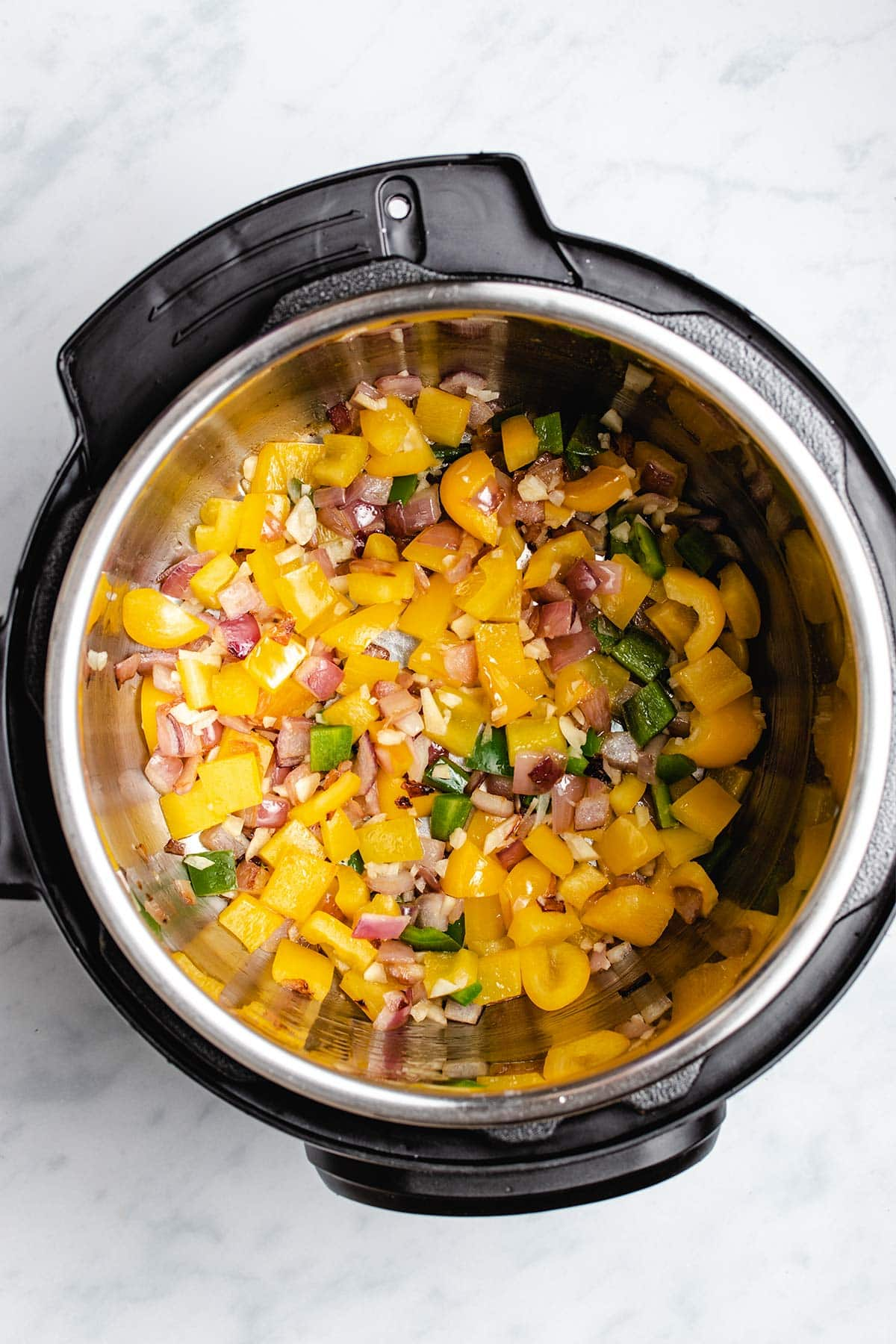 sautéed red onion, yellow bell pepper, jalapeño and garlic in an Instant Pot