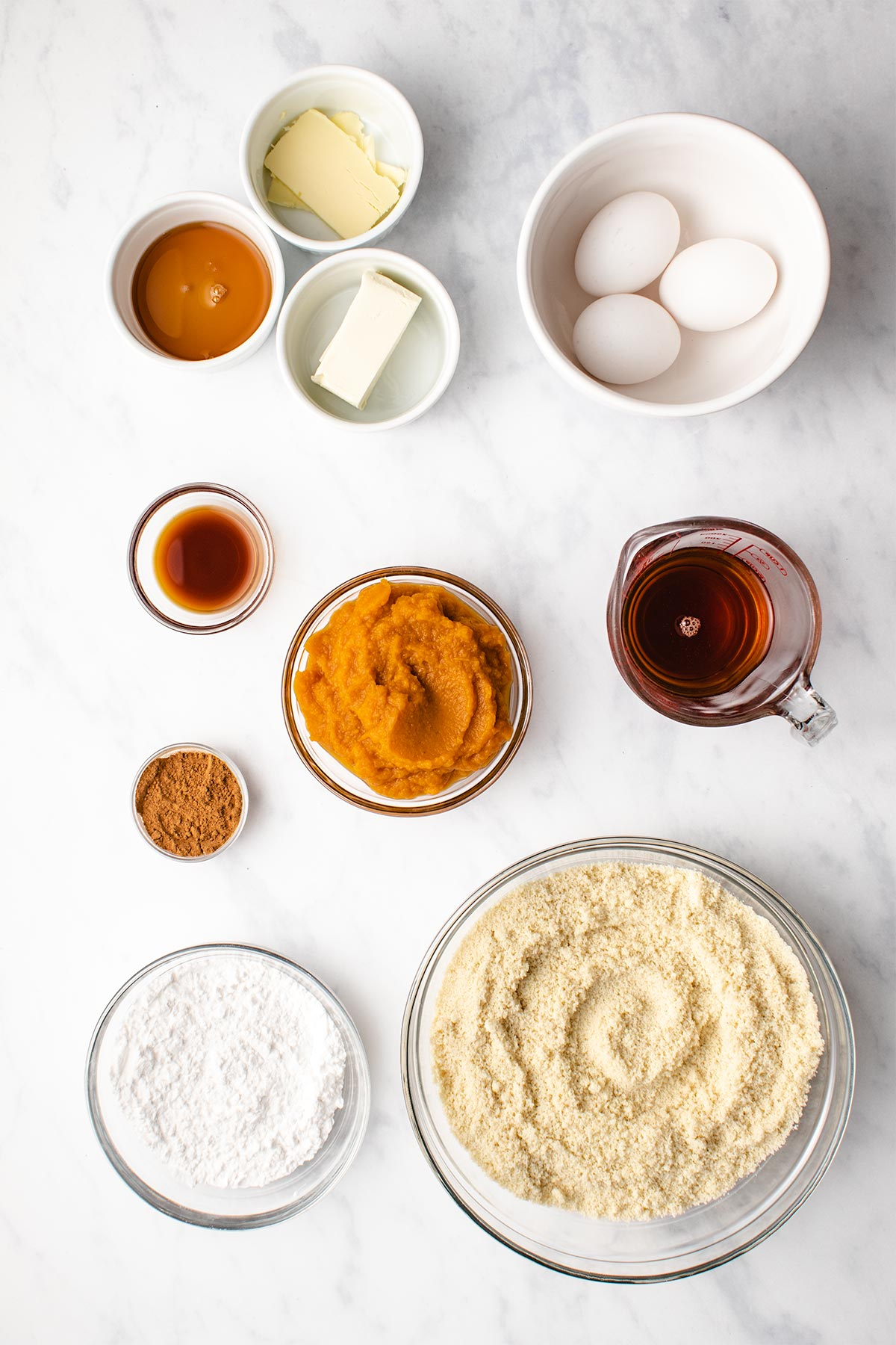 Ingredients needed for almond flour pumpkin bread in bowls viewed from overhead.