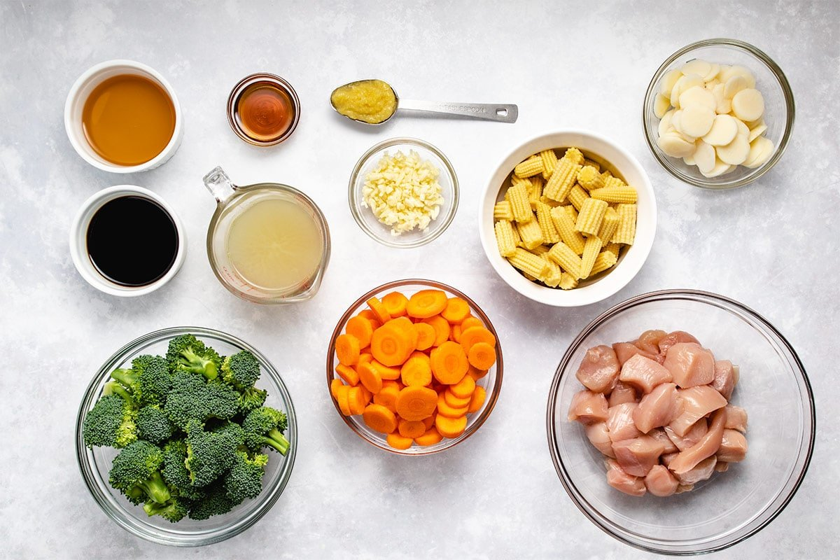 Ingredients needed for Instant Pot Chicken Stir Fry in bowls viewed from overhead.