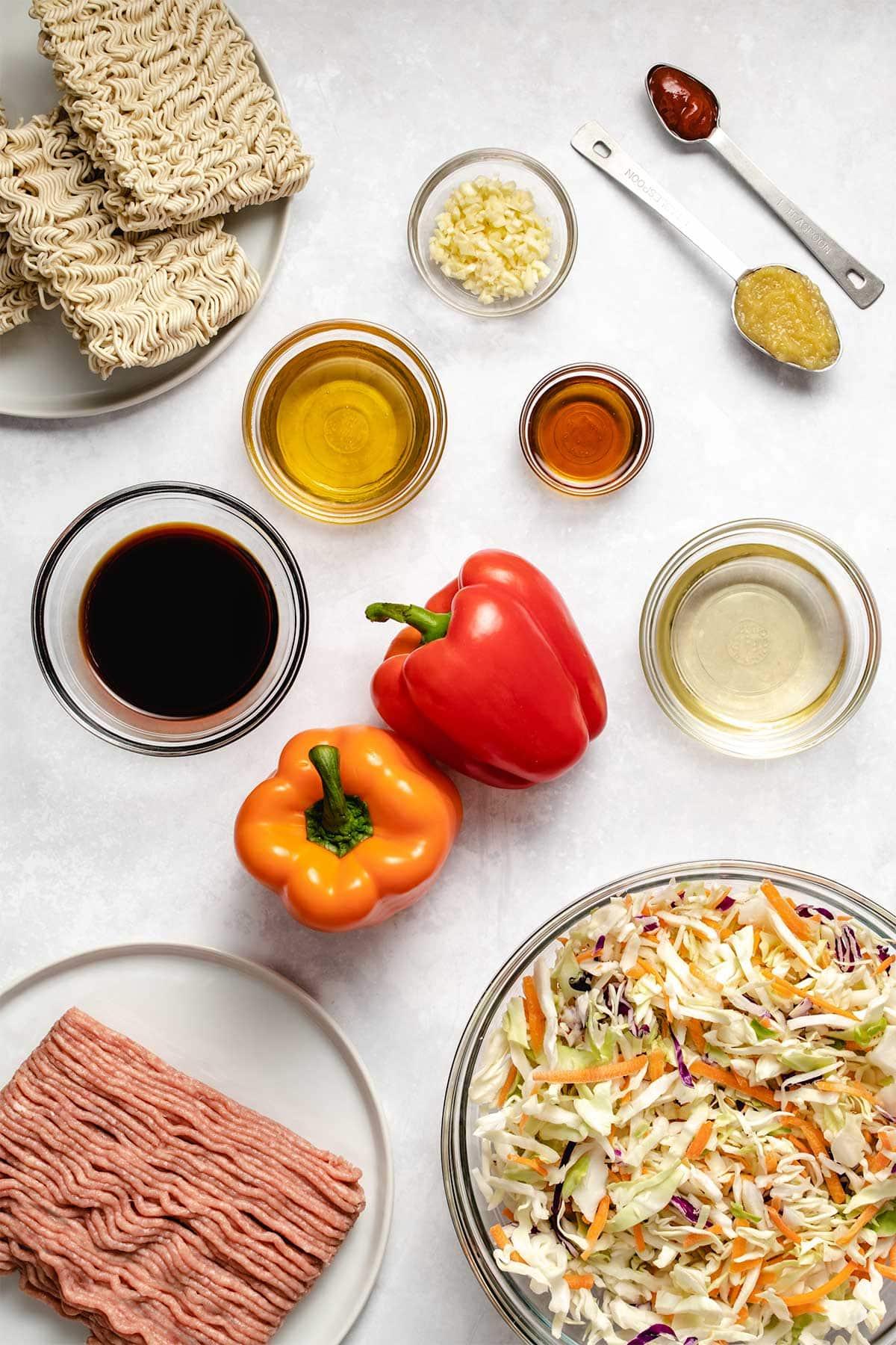 Ingredients needed to make Chicken Ramen Stir Fry viewed from overhead.
