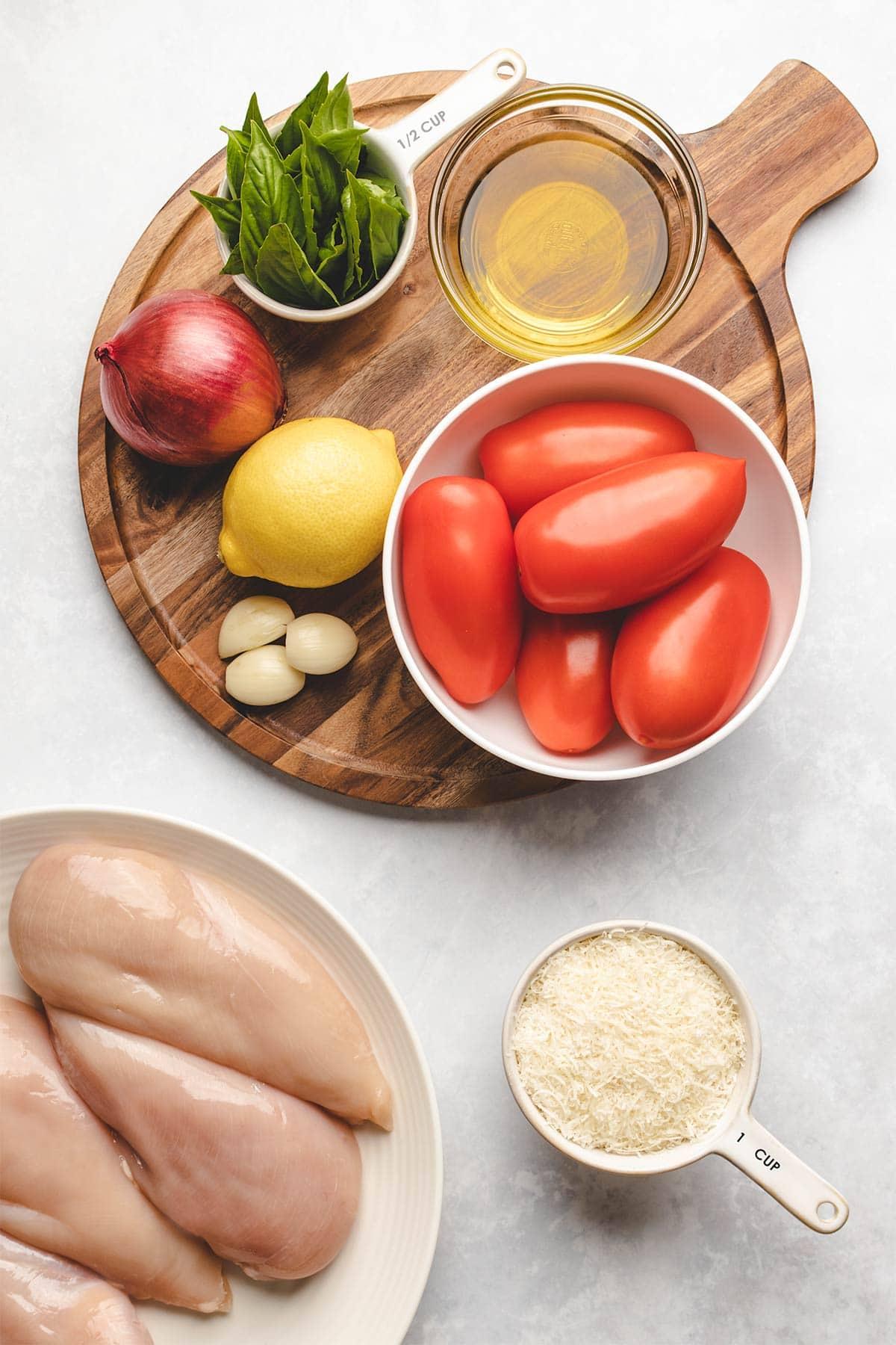 Ingredients needed to make Bruschetta Chicken Bake viewed from overhead.