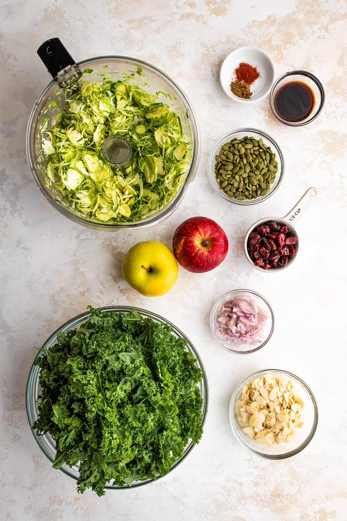 Ingredients for Kale and Brussels Sprouts Salad viewed from overhead.