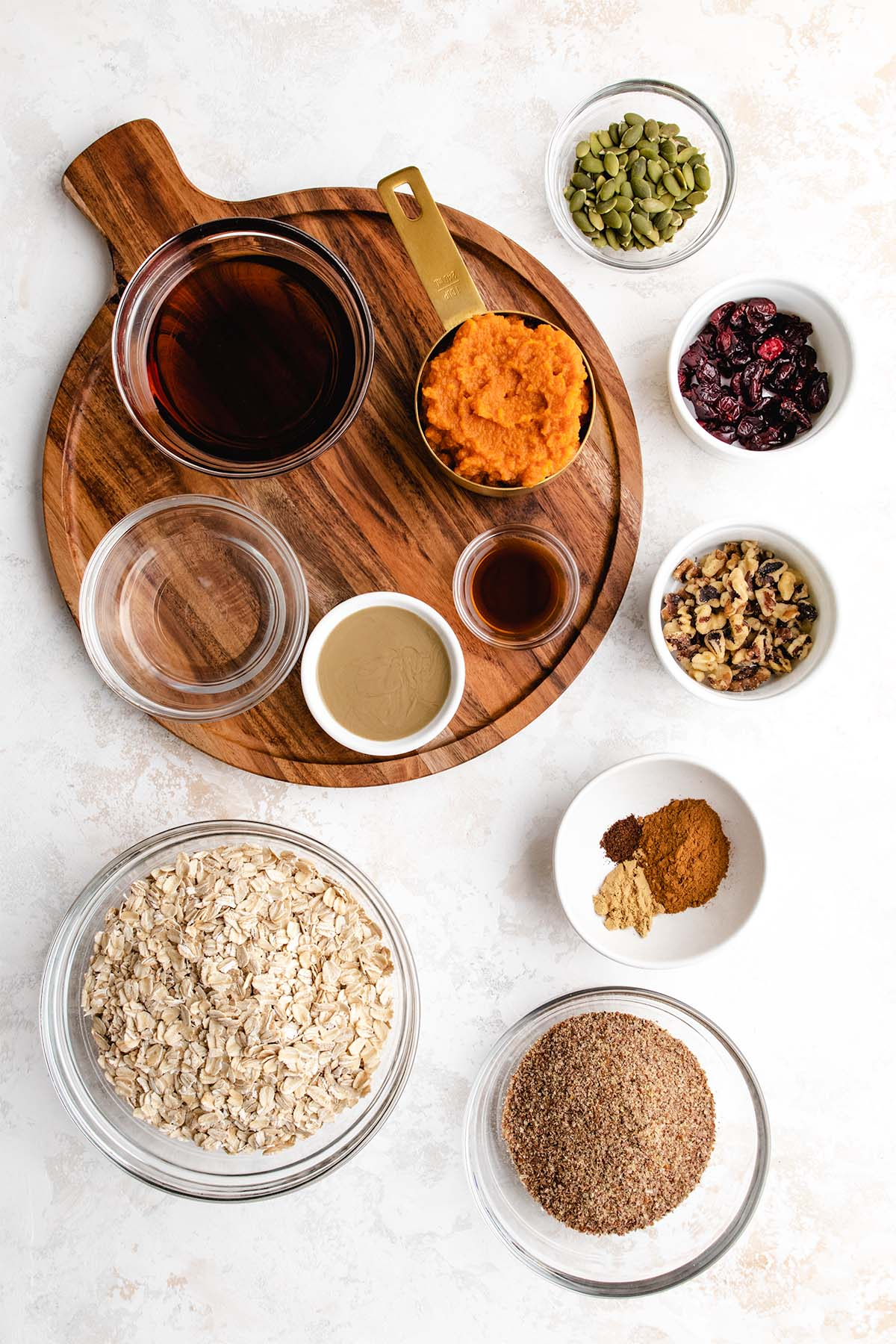 Ingredients needed to make Pumpkin Breakfast Cookies, viewed from overhead.